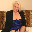 Blonde mature slut playing with her toys