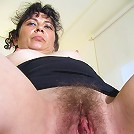 Hairy mature slut playing with her pussy