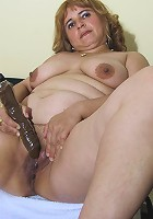 Chubby mama playing with a big dildo