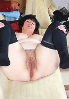 Big breasted housewife playing with her naked body