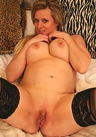Blonde mama with big tits getting frisky
