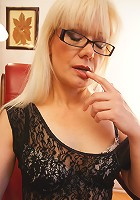Sexy mature librarian getting her pussy wet