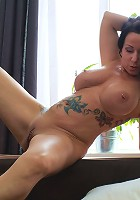 This Tattooed MILF loves to play with her pussy