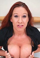 Hot red MILF playing with her big tits