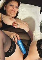 Horny housewife getting herself off on her bed