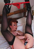 Horny red MILF loves to get her rock on