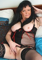 Naughty mature lady playing on her bed