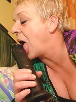 Horny mature slut playing with her big toy