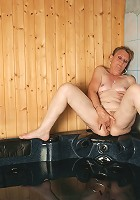 Horny mature slut playing alone in the bath and sauna