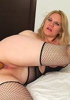 Naughty blonde mature slut teasing her pussy