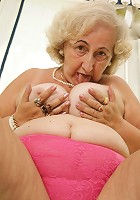 Horny mature slut playing with her pussy on her couch