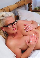 Hot big breasted housewife playing on her bed