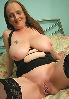 Big titted mama playing with herself all day long
