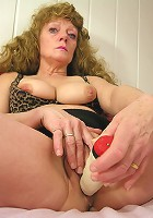 Check out this horny mature slut playing with herself