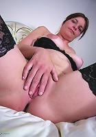 This horny housewife loves to flash her tits