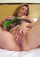 This hot mature slut loves playing with her cucumber