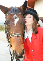 Classy mature slut playing with herself in a barn in front of a horse