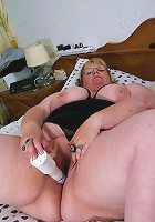 Big mature mama playing with her toy