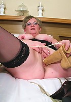 Housewife Natalie plays on bed with a toy