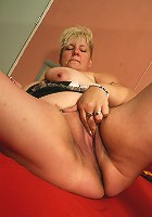 naughty blonde mama playing with her toy