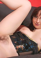 Horny housewife pleasing herself on the couch