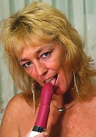 Kinky mature slut playing with her toy