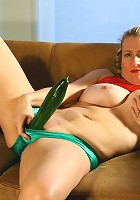 Naughty mature slut playing with a cucumber