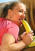 Naughty housewife playing with a banana