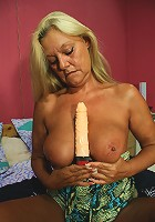 Blonde mature slut playing with her dildo