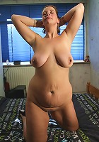 Big breasted mama playing with her pussy