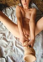 Classy mature lady masturbating in a barn