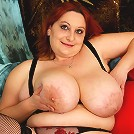 Huge breasted mature slut playing
