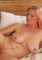 Horny housewife showing off proudly her two best assets