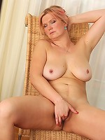 Horny housewife with big tits playing alone