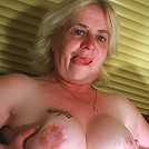 blond mature slut showing you her curves