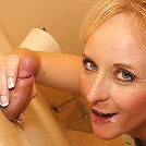 This horny blonde mature slut loves a cock coming through a hole