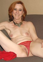This red mature slut loves to get fisted and take on huge toys