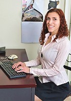 Red haired babe gives coworkers glimpses of skin in her office station