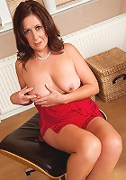 Elegant busty housewife spreads her pink pussy lips