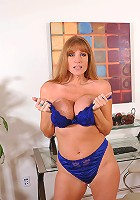 Seductive mature secretary strips off her office attire exposing her shapely body
