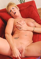 Classy blonde granny satisfies her pink pussy with a sex toy