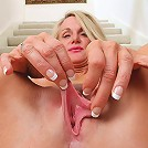 Anilos Jena Jackson strips and spreads her hot milf pussy