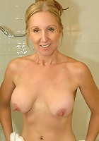 Dripping wet milf with big tits fucks a huge toy
