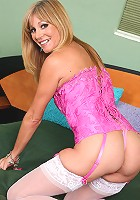 Blonde cougar Jessica Sexxxton looks incredible in her sexy pink corset