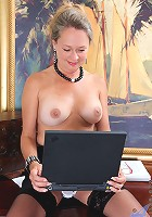 Lovely busty mom strips in front of her laptop