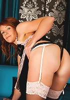 Redhead milf in sexy lingerie posing with a nice white thong