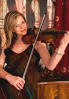 Louise Pearce in her sexy evening wear posing with her violin