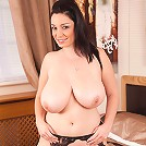 Busty cougar Michelle Bond spreads her pussy to show her pretty clitoris