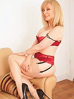 Busty milf Nina Hartley looks sexy in a pair of lacy panties and heels