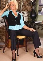 Blonde milf Rebecca flaunts her hot body in seductive office attire